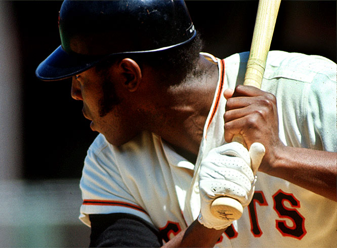 Giant first baseman Willie McCovey launches his 500th career home run over the left field fence at Fulton County Stadium, becoming the 12th player to accomplish the feat.