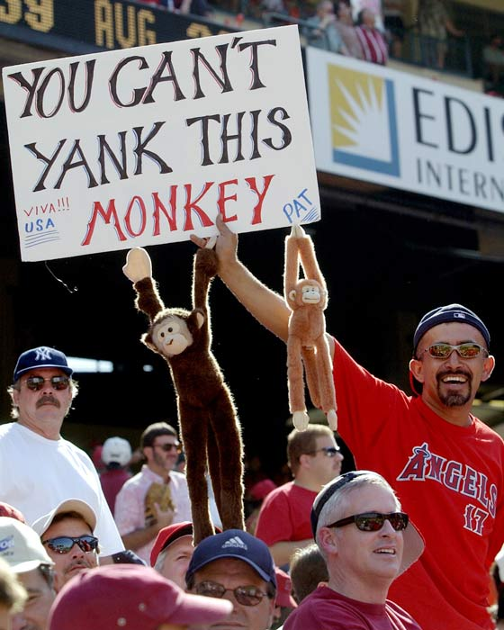 "Thanks to the Angels' video crew playing a clip from the 1994 movie ""Ace Ventura, Pet Detective"" on the JumboTron, the Rally Monkey is born. With the words ""Rally Monkey"" superimposed over a monkey jumping up and down in the Jim Carrey movie, the crowd goes wild as Anaheim scores two runs in the bottom of the ninth to beat the Giants, 6-5."