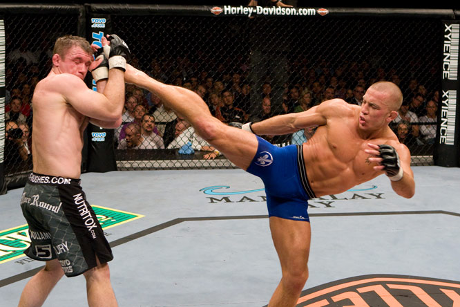 UFC welterweight champion St. Pierre (blue trunks) has racked up a 16-2 record, with key wins against Matt Serra, Matt Hughes, B.J. Penn and Sean Sherk.