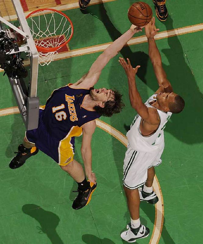 The Lakers' Pau Gasol and P.J. Brown battle for a rebound. Gasol collected 15 points and eight rebounds, while the 38-year-old Brown gave the Celtics some valuable minutes off the bench.