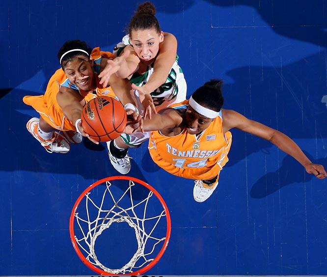 Wooden Award winner Candace Parker (left) battles for a rebound with Notre Dame's Melissa D'Amico and teammate Alexis Hornbuckle.