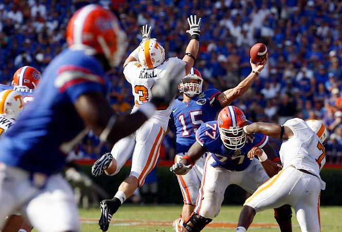 Heisman winner Tim Tebow unloads a pass down the middle over leaping Tennessee linebacker Ryan Karl in Florida's 59-20 win.