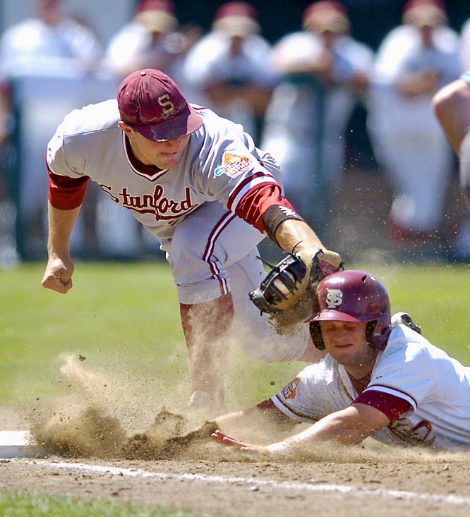 Stanford first baseman Brent Milleville, left, tags Florida State's Tommy Oravetz in the sixth inning on a throw from the Cardinal catcher.
