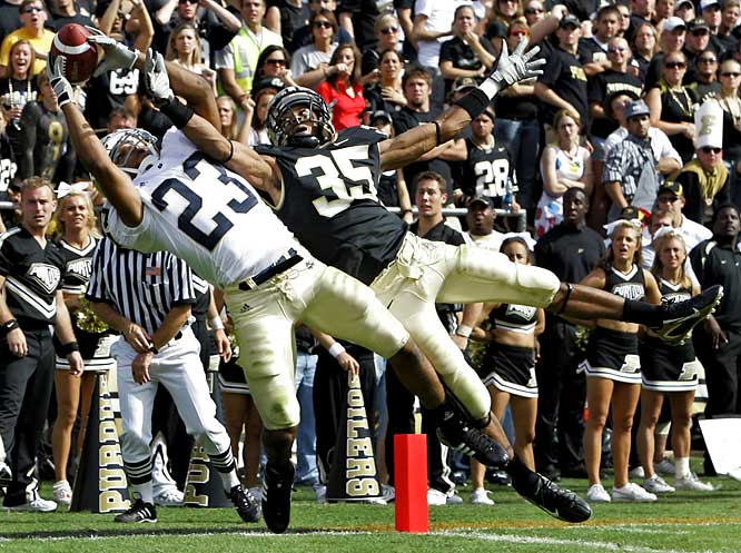 Notre Dame's Golden Tate (23) makes a touchdown catch in the fourth quarter over Purdue cornerback David Pender to bring the Fighting Irish within seven -- the closest they would get to the Boilermakers before losing 33-19.
