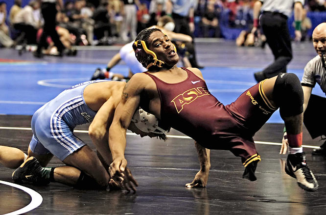 Despite being born with one leg, Arizona State's Anthony Robles, right, escapes from the arms of Columbia's Brandon Kinney en route to a 125 lb. class match victory on a 12-5 decision.