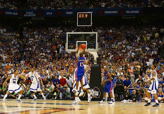 Capping a nine-point comeback in the final 2:12, Mario Chalmers hits a game-tying three-pointer over Derrick Rose, sending the championship game to overtime, where the Jayhawks would win their first title in 20 years.