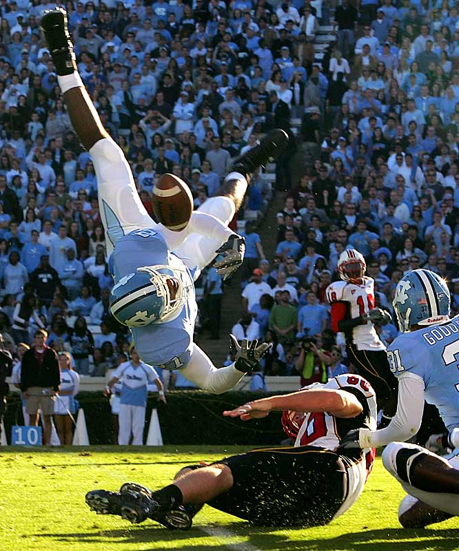 Freshman Tar Heel safety Deunta Williams flies through the air to break up a pass in front of Terrapin center Joey Haynos just weeks before being named ACC Defensive Rookie of the Year and First-Team Freshman All-America.