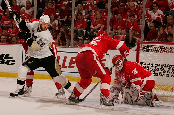 Winger Adam Hall (28) ups the Penguins' lead to 2-0 in the first period by beating goalie Chris Osgood, who had his shakiest outing of the 2008 playoffs.