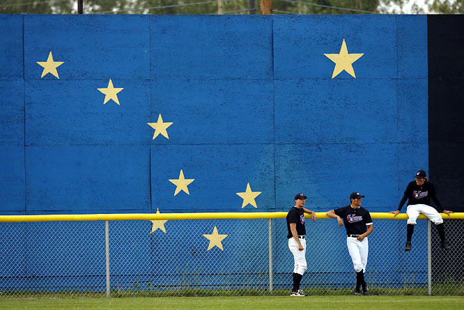 The eight-starred Alaskan state flag serves as the centerfield backdrop at Fairbanks' Growden Memorial Park, home of the Goldpanners and the Midnight Sun Game -- Near midnight on each summer solstice, the game -- which begins at 10:30 p.m. with no use of artificial lights, and is the signature event of the Alaskan Baseball League -- is interrupted for a ceremony that includes the signing of the state song, <i>Alaska's Flag</i>. The song's last two lines are: <i>Alaska's flag--to Alaskans dear/ The simple flag of a last frontier.</i>