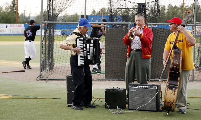 "Bill Stroecker, center, is the trumpetist for the Frigid-Aires, Growden's house band, which runs through a set of jazz standards prior to each Midnight Sun Game. Stroecker's father, Eddie, was the catcher in the very first Midnight Sun Game, in 1906, and Bill still serves as the president of the Goldpanners. Between Stroecker (who complained of ""sticky valves"" during his 2007 set), accordion player Rif Rafson, and bassist Karl Carlson, the Frigid-Aires have spent a combined 206 years in Alaska."