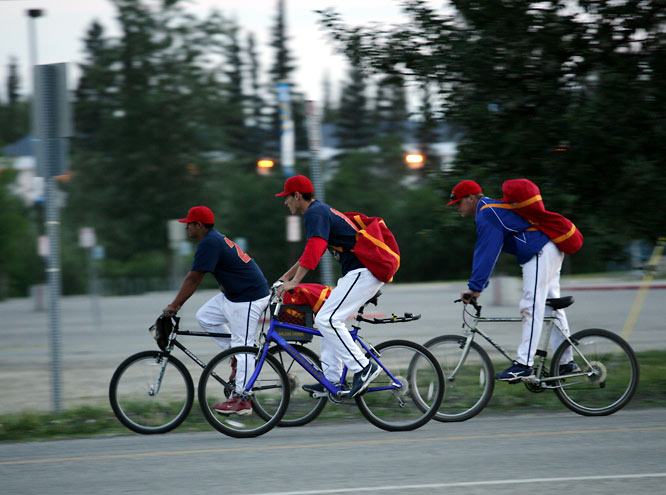 The primary means of transport for Goldpanners players who <i>did</i> have host families was of the two-wheel variety. Following the conclusion of the 102nd Midnight Sun Game, a pack of 'Panners, including Kent State shortstop Chris Tremblay (center) pedaled off into the Arctic glow -- still wearing full jerseys -- at nearly 2 a.m.