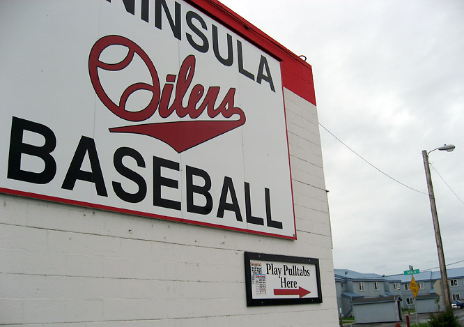 "In Kenai, the Peninsula Oilers support their team with the profits from a bingo hall and pull-tab outlet that's nicknamed the ""Bingo Hilton"" -- because it also offers claustrophobic bunk-bed lodging for visiting teams through its back door. The sign inside reads, in part, ABSOLUTELY NO CLEATS ARE ALLOWED TO BE WORN IN THE HILTON AREA."