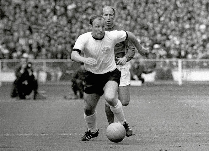 The Germans eliminated Spain from the tournament with a narrow victory in the final group stage game, securing the result with an 84th-minute goal from Uwe Seeler (pictured, against England). But Germany's first goal -- a left-footed strike from Lothar Emmerich from an impossible angle -- remains one of the most famous moments in the team's history.