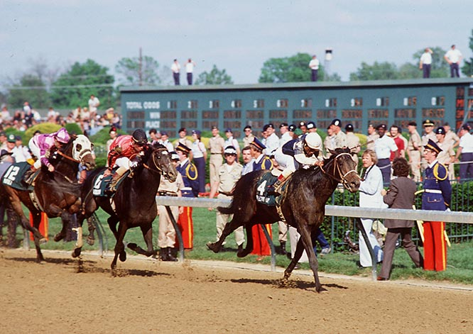 Pulling away from the Derby pack on the homestretch (pictured) and outdueling Bold Ego by a length in the Preakness, Pleasant Colony fell short by three lengths in the Belmont's longer 1 1/2 mile race.