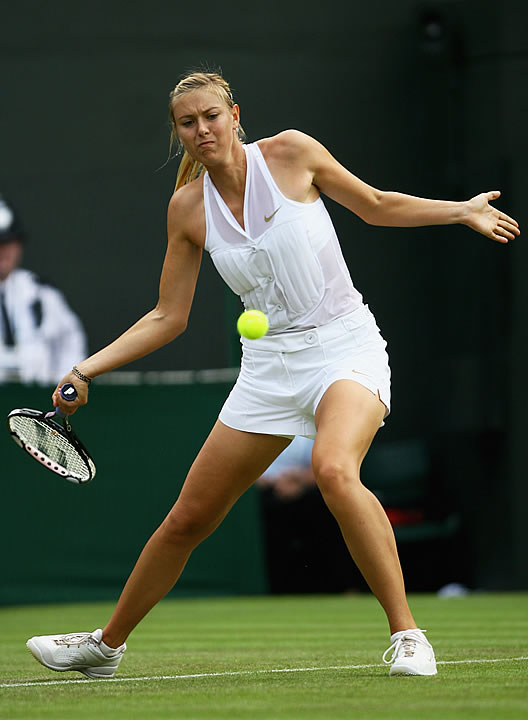 Sharapova sported a tuxedo dickey over a sheer white top and, for the first time in a grand slam, traditional men's tennis shorts.