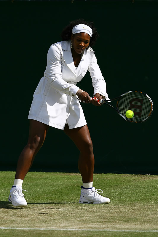 "Serena Williams was ready for any and all weather in this white trench coat. After her 7-5, 6-3 victory, she explained, ""I love coats. And I don't know why because I live in Florida. So it doesn't really add up."""