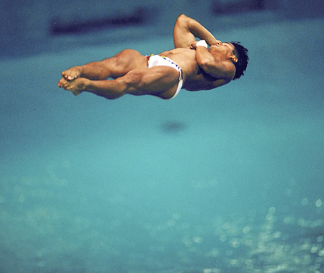 American diving legend Louganis earned his first trip to the Olympics as a 16-year-old in 1976 at Montreal, where he won the silver medal in the 10-meter platform. However, he would have to wait eight years before embarking on his dominant streak, in which he won back-to-back gold medals in both the 10-meter platform and 3-meter springboard in 1984 and '88. At the 1988 Games, he won his medals after suffering a concussion when he hit his head on the springboard during the preliminaries.