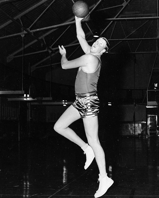 A three-time All-America center and Big-Seven scoring leader, Clyde Lovellette was the first college basketball player to lead the country in scoring and win a national championship in the same year. He led the Jayhawks to a 1952 NCAA title, winning the Final Four's Most Outstanding Player award and scoring a then-NCAA-record 141 tournament points (35.25 points per game). He was also the first basketball player to play on an NCAA, Olympic and NBA championship team.