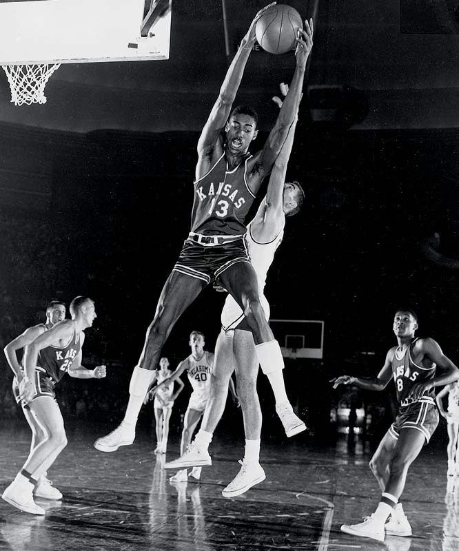 In his first NCAA varsity basketball game, the 7-foot-1 Wilt Chamberlain had 52 points and 31 rebounds, breaking both college records. He averaged 29.9 points and 18.9 rebounds in his two seasons at Kansas and was a track and field star as well. Despite losing to the Tarheels in the 1957 NCAA Championship, the first team All-America center still won the Most Outstanding Player award before going on to be one of the greatest, most dominant players in the NBA.