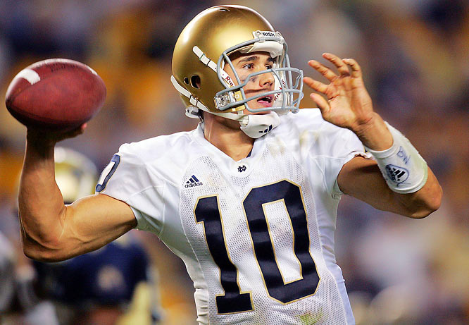 <italics> With it being St. Patrick's Day weekend, SI.com presents our Top 10 athletes to ever play for Notre Dame</italics>. Brady Quinn would be higher on this list if he could have won the big game, but this quarterback destroyed 36 Irish records (10 career, 12 single-season, 4 single-game, 10 miscellaneous) during his career in South Bend. These include career pass attempts (1,602), completions (929), yards (11,742), yards per game (239.6), TD passes (95) and lowest INT percentage (2.43). His 29 wins as a starter tie him for the most in school history. In 2005, he finished third in the Heisman Trophy voting. Quinn led the Fighting Irish to two BCS bowls but lost both.
