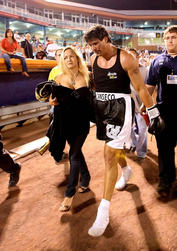 Meanwhile, Canseco could only exit Bernie Robbins Stadium with a sullen expression and his girlfriend Heidi Northcott.
