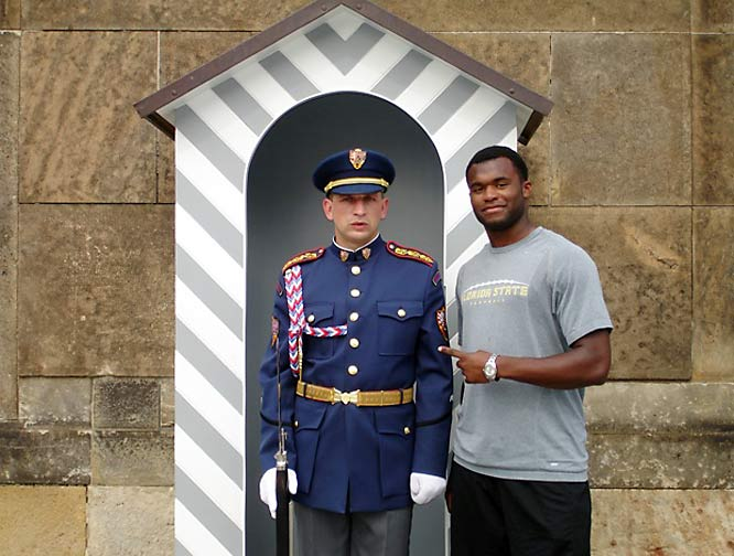 Rolle poses with a guard in front of Prague Castle in the Czech Republic.
