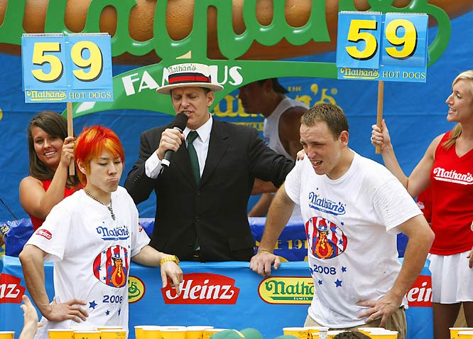 In previous years, the row of hot-dog crazies had 12 minutes to prove their digestive prowess. But this year, after it was revealed that the first contest in 1916 was only 10 minutes long, the contest was rolled back to match. By the end of the allotted time, Chestnut and Kobayashi were still neck and neck at 59 dogs.