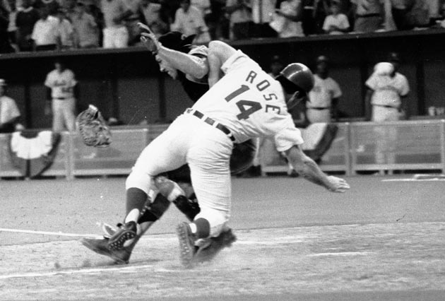 In the 12th inning of the All-Star game, Pete Rose bowls over Ray Fosse at the plate to score the deciding run in an exciting 5-4 National League victory at Riverfront Stadium. The Indian catcher, whose career was shortened because of the collision, had entertained 'Charlie Hustle' as a dinner guest the previous night.