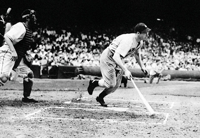 In this picture, Yankees slugger Joe DiMaggio singles in the first inning at Cleveland, extending his record hitting streak to 56 games.