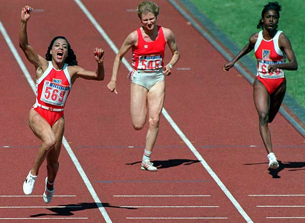 Florence Griffith Joyner of USA sets the 100-meter women's record with a speed of 10.49 seconds.