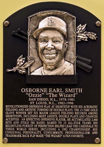 During his induction speech at the Hall of Fame ceremonies in Cooperstown, with the song Somewhere Over the Rainbow playing in the background and a copy of 'The Wizard of Oz' in his hands, Ozzie Smith compares his baseball career to Dorothy's away trip from Kansas. Citing the recipe for his success during his 19-year career with Cardinals and Padres, the 47-year-old tells the crowd he had the mind to dream, which the Scarecrow cherished, a heart to believe, which the Tin Man wanted, and courage, which the Lion lacked, in order to persevere.