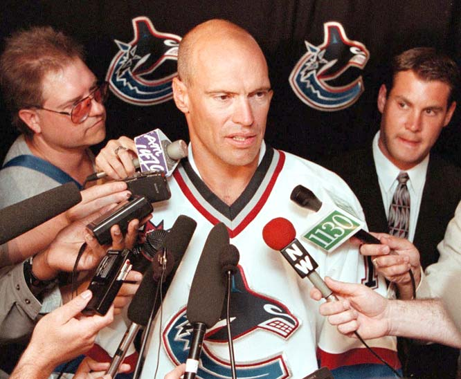 Mark Messier signs a three-year contract with the  Vancouver Canucks.