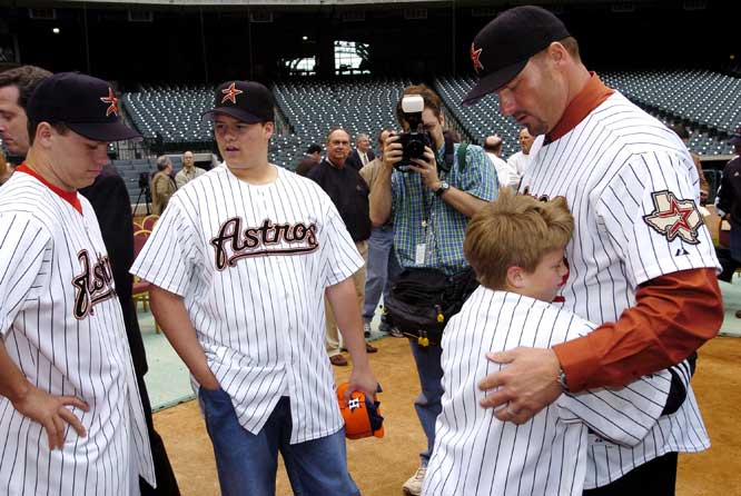 Roger Clemens is ejected from the little league game of his son, Kacy, for arguing a call and spitting sunflower seeds at an umpire's leg.