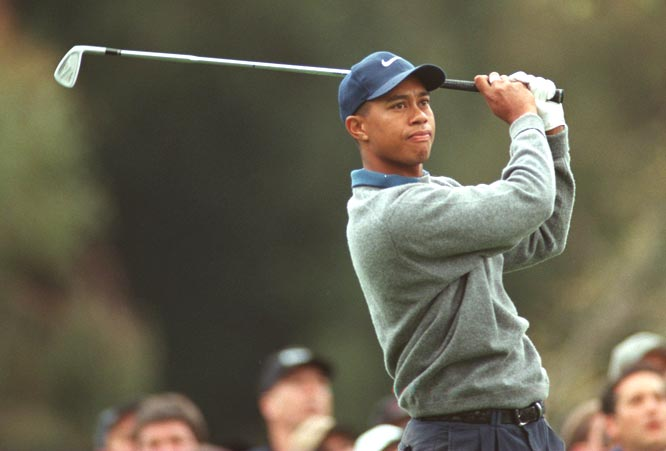 Two months after winning The Masters, 21-year-old Tiger Woods wins the Western Open.
