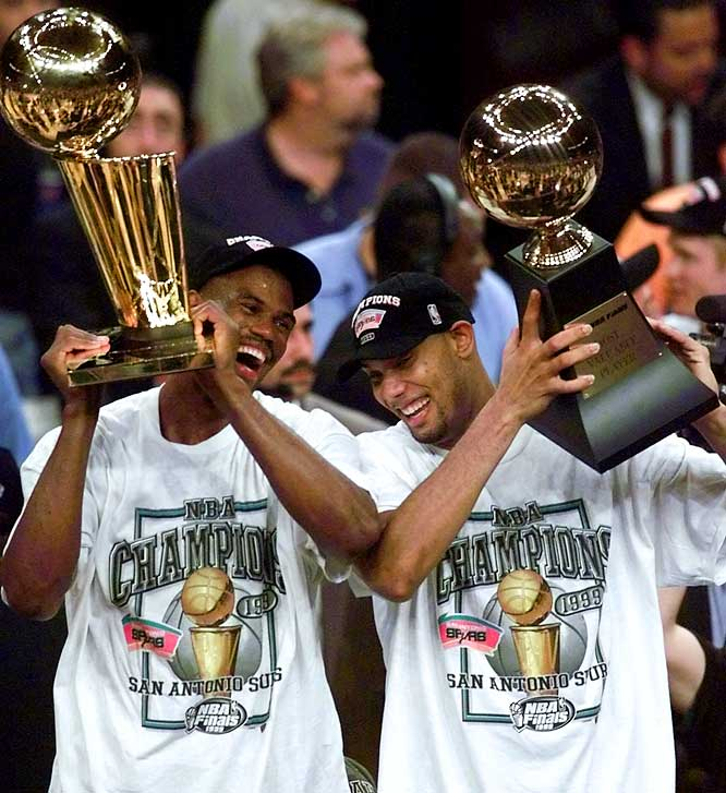 "After a 50-game regular season that didn't start until Feb. 5, the Tim Duncan- and David Robinson-led Spurs beat the Knicks in the Finals to win the first of their four championships. Some critics considered the championship tarnished because it followed a shortened season; Phil Jackson, for one, suggested it be accompanied by an asterisk, a remark that helped fuel the Spurs-Lakers rivalry when the Zen Master became Los Angeles' coach in 1999. Steve Kerr, a member of the title team, responded, ""They still gave us a ring, and there's no asterisk on the ring."""