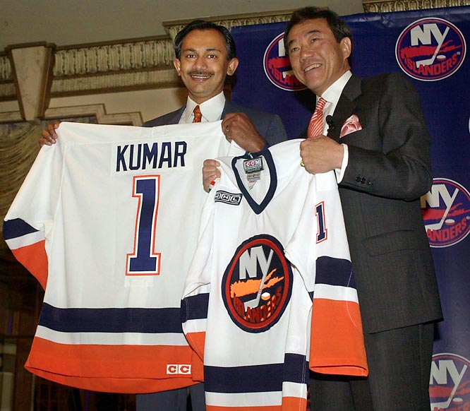"In April 2000, the ""Millstone Years"" ended as the team was bought by the deep-pocketed duo of Charles Wang and Sanjay Kumar, who vowed to restore the Isles to their former glory. (Seven years later, Kumar was sent to jail for 12 years for accounting fraud at his software company.) Wang bought the Isles without any guarantee that their lease at the Coliseum would be changed. They get nothing from parking and concessions and only one-third of the crumbling arena's advertising revenues."