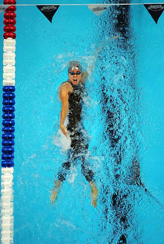 Natalie Coughlin qualified for her second Olympic Games tapping the wall in the 100-meter backstroke quick enough to lower the bar on the world record she set the day before.  She also qualified in the 200m IM, 100m free and 4x100m free relay.