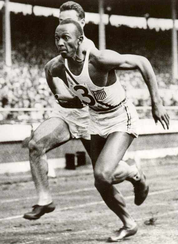 In the 1936 Games in Berlin, with Nazi leader Adolf Hitler in attendance, Owens became the first American to win four gold medals in a single Olympics. He set three records in winning the long jump, 200 meters and the first leg of the 4x100-meter relay, and also won gold in the 100 meters.