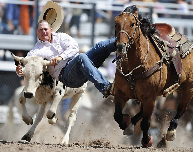 Dan Cathcart goes down with his cap during the 112th Cheyenne Frontier Rodeo Days in Cheyenne, Wyoming.