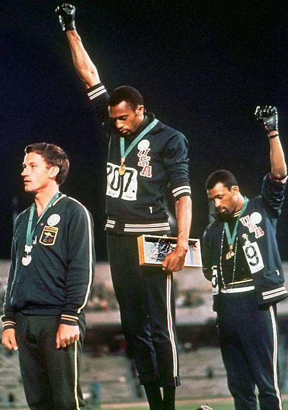 In the most memorable Olympic medal ceremony, the two American sprinters stood with one black-glove-covered fist in the air and head down, donning only black socks on their feet. As symbols of black power and unity during the civil rights movement, Smith and Carlos were also gold and bronze medalists, respectively, in the 200 meters. Their stance is now a statue at San Jose State University, where they were teammates the year of the Games.