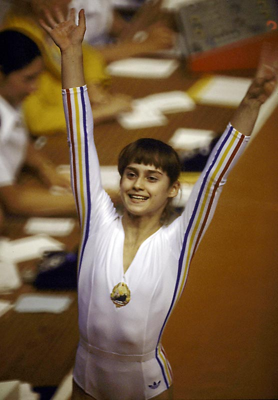 "At just 14 years old, Romanian Nadia Comaneci won the hearts of spectators and judges alike after scoring an unprecedented ""perfect 10""  on the uneven bars at the 1976 Games in Montreal. The scoreboards weren't equipped to display double-digit figures because the manufacturers assumed no one would ever achieve such a feat. She went on to score six more 10s in Montreal."