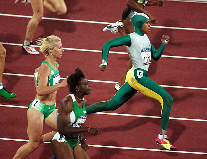 After winning silver in the 400 meters and becoming the first Aboriginal athlete to compete for Australia at the 1996 Games, runner Cathy Freeman wasn't satisfied. As one of the favorites entering the 2000 Games, she took the pressure in stride as she won the event that she had trained for decades.