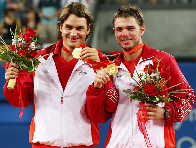 Roger Federer finding a bit of sunshine in a turbulent season by winning a gold medal in doubles, with Stanislas Wawrinka.