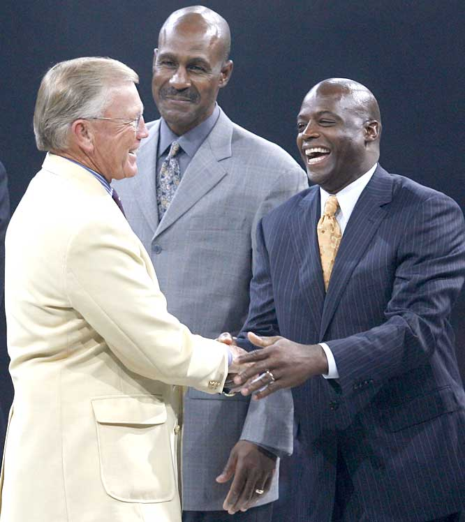 Hall of Fame coach Joe Gibbs (left) welcomes two Redskins greats, receiver Art Monk and Darrell Green (right), at the Legends Dinner on Friday night. Gibbs, Monk and Green combined to win eight Super Bowls.
