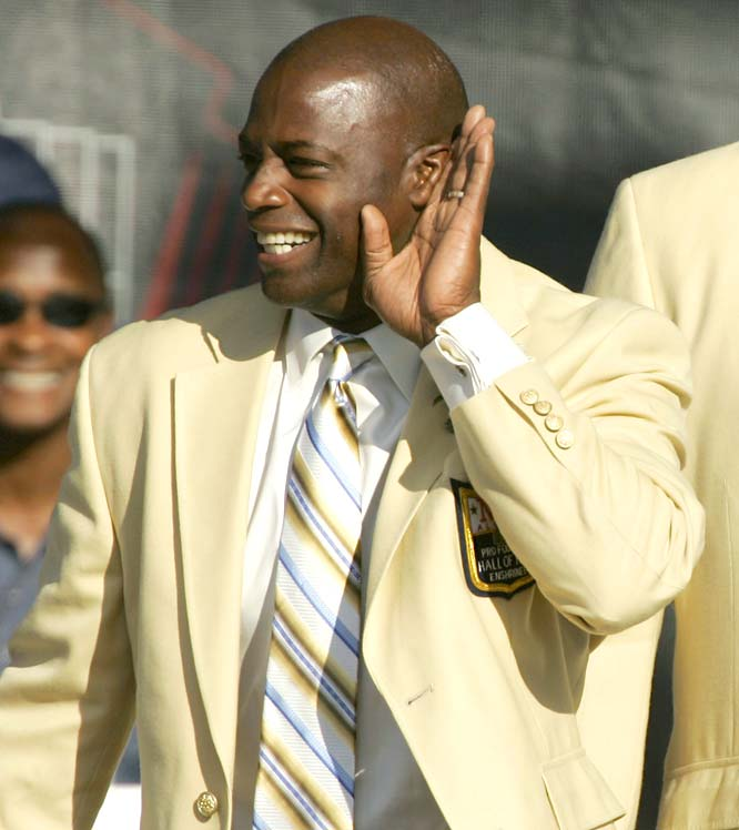 """Hall of Famer Darrell Green incites the pro-Redskins crowd at Fawcett Stadium upon his initial introduction. In his 20 years in the league (1983-2002), Green often held the title of """"NFL's Fastest Man."""""""