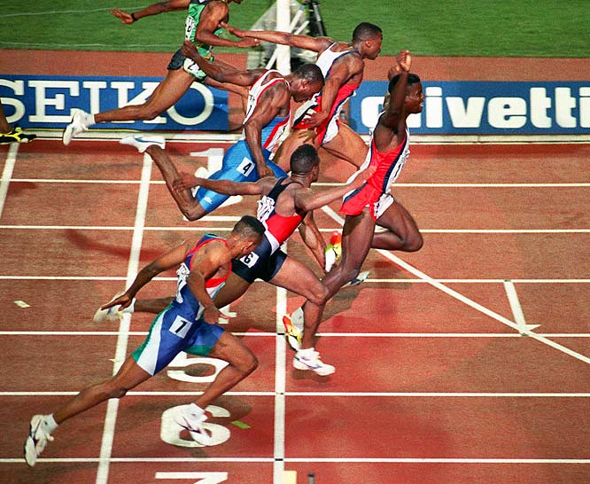 Carl Lewis sets the 100-meter world record with a time of 9.86 seconds.