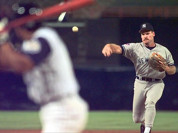 New York Yankee third baseman Wade Boggs pitches a scoreless inning against Anaheim.