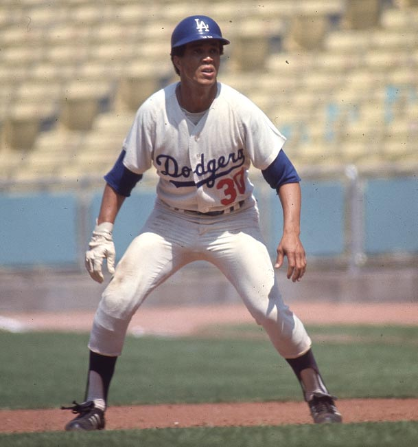 Dodgers protest the wetting down of Candlestick Park's infleld to slow speedster Maury Wills down.