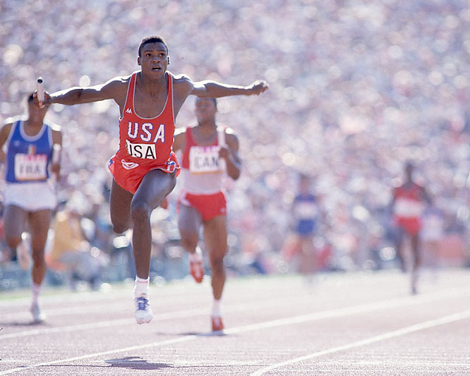Carl Lewis wins his fourth gold of the Summer Olympics when the 4 x 100 meter relay team he is anchoring finished in a time of 37.83 seconds, a new world record.