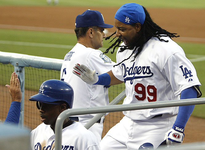 It's all smiles in the Dodger dugout after Manny's first Chavez Ravine dinger.